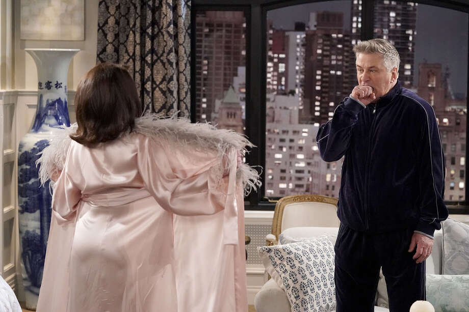 "WILL & GRACE -- ""It's A Family Affair"" Episode 116 --  Pictured: (l-r) Megan Mullally as Karen Walker, Alec Baldwin as Malcolm Widmark -- (Photo by: Chris Haston/NBC) Photo: Credit: Chris Haston/NBC / 2018 NBCUniversal Media, LLC. Credit: Chris Haston/NBC"