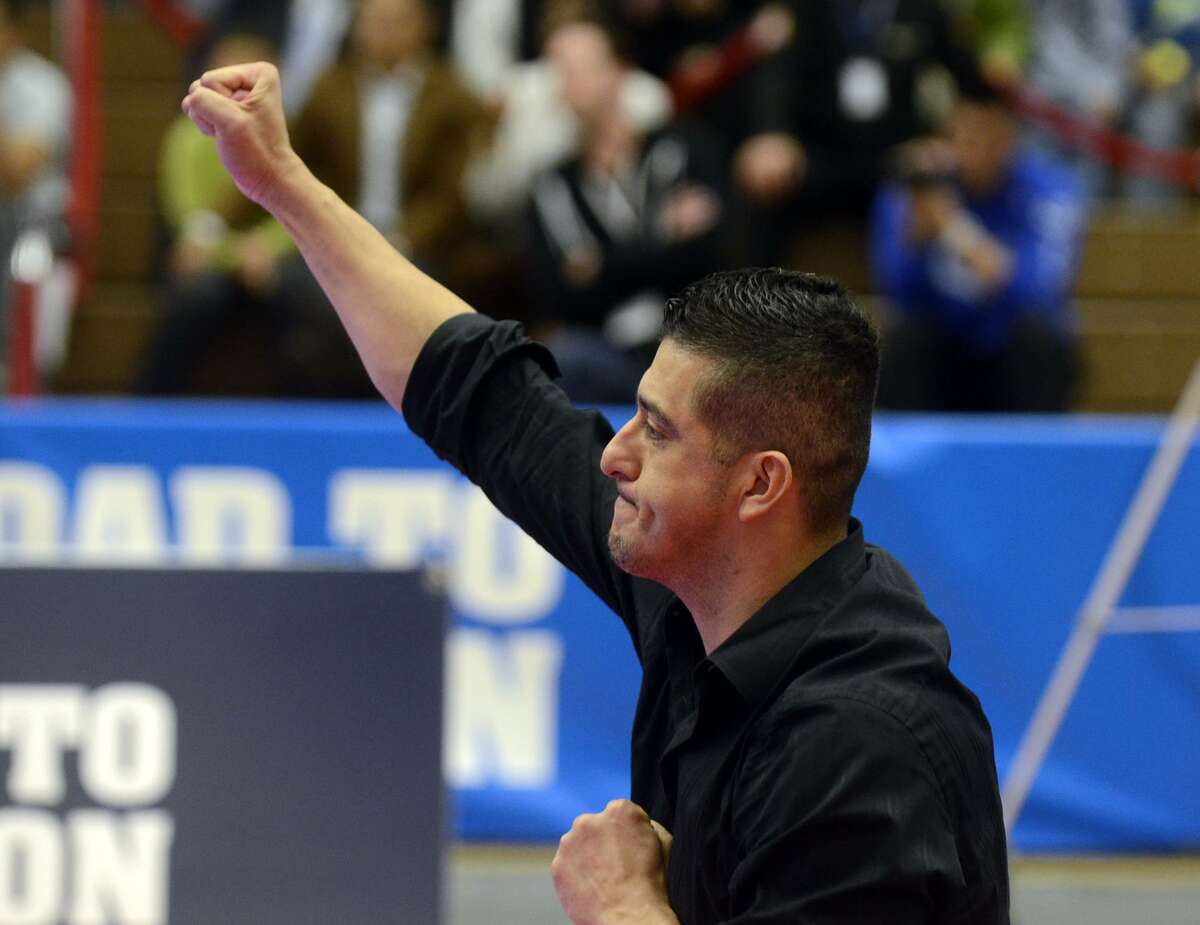 Jean Lopez erupts in a cheer after his brother Mark scored points against Terrence Jennings during the 2012 Olympic Trials finals for Taekwondo at the U.S. Olympic Training Center in Colorado Springs, Colo., Saturday, Mar. 10, 2012. (BryanOller/Special to the Houston Chronicle)