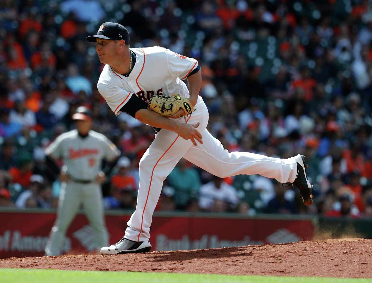 Houston Astros relief pitcher Brad Peacock (41) pitches during the seventh inning of an MLB baseball game at Minute Maid Park, Wednesday, April 4, 2018, in Houston.