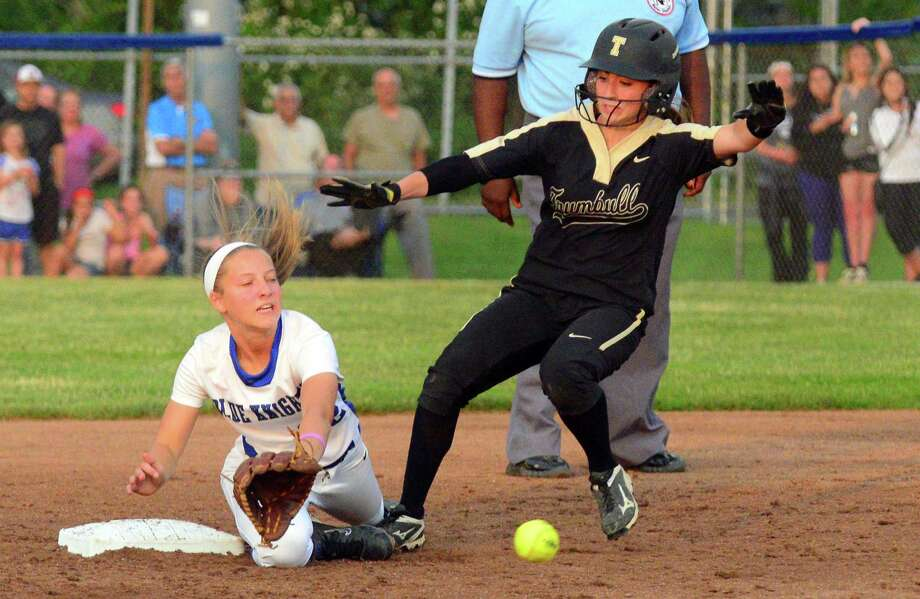 Trumbull's Maggie Coffin reaches second base as Southington Chrissy Marotto receives the throw during Class LL final softball action in West Haven, Conn., on Saturday June 10, 2017. Marotto misses the throw allowing Coffin to reach third. Photo: Christian Abraham / Hearst Connecticut Media / Connecticut Post