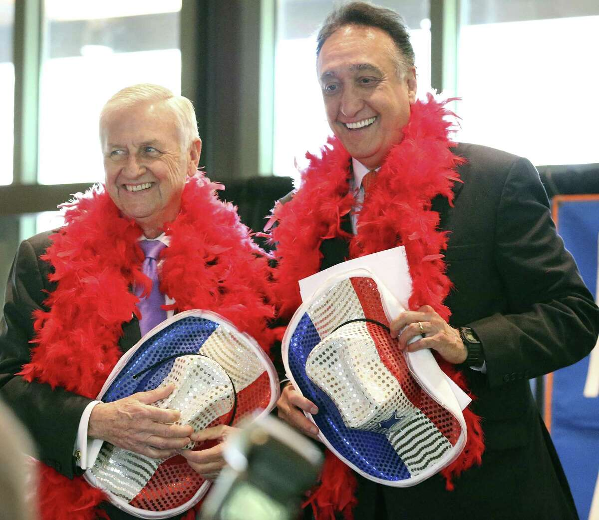 Emcees John Montford and Henry Cisneros are asked to wear special attire for their appearance at a luncheon for the Greater San Antonio After-School All-Stars program at the Briscoe Western Art Museum on April 4, 2018.