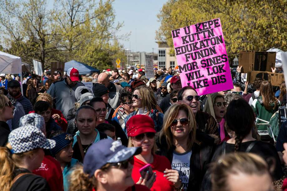 Teachers and their supporters rally during a strike Tuesday to seek more funding for schools at the Oklahoma Capitol building in Oklahoma City. Photo: Scott Heins / Bloomberg
