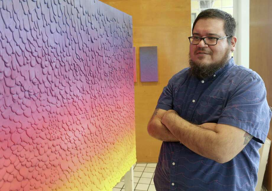"""John Medina used more than 400 glue sticks on each of three panels that art part of """"The Sunset Belongs to Us,"""" an installation on display in the Main Gallery at Artpace. Photo: William Luther /San Antonio Express-News / © 2018 San Antonio Express-News"""