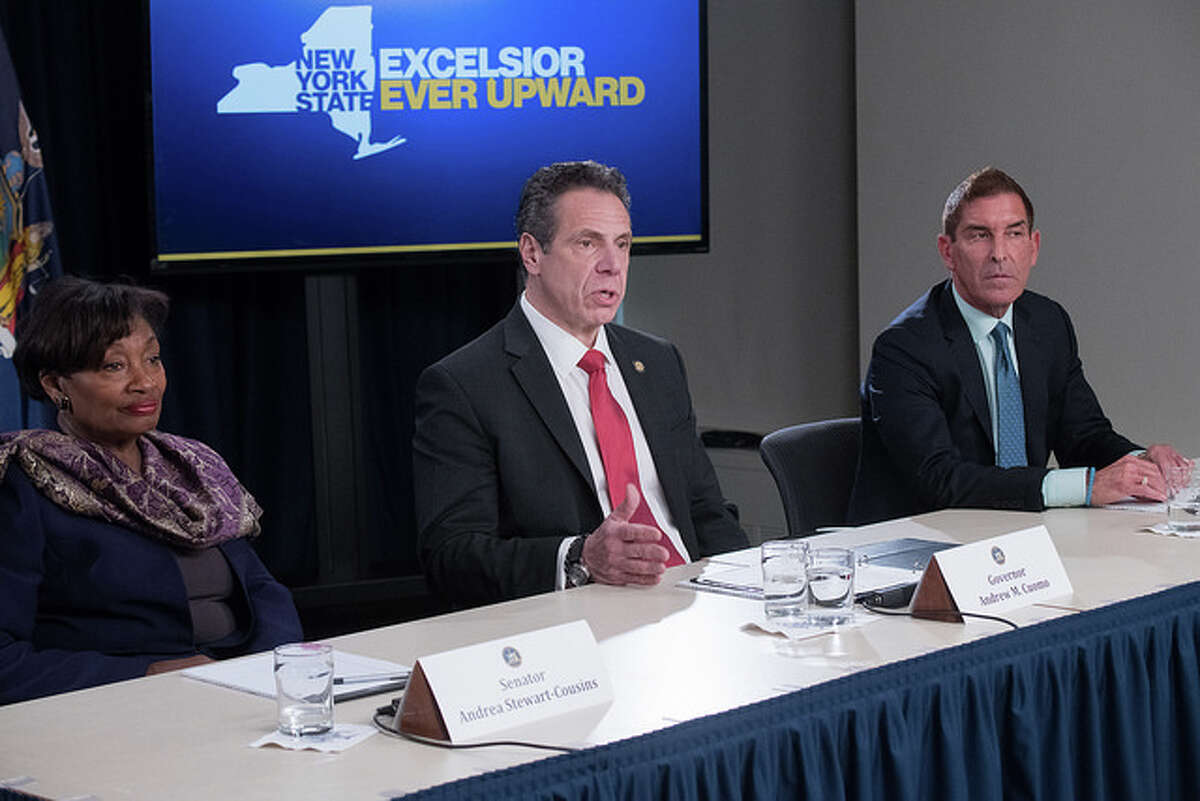 Gov. Andrew Cuomo presides over reunification of the Senate Democratic Conference on April 4, 2018. (Office of Gov. Andrew Cuomo)