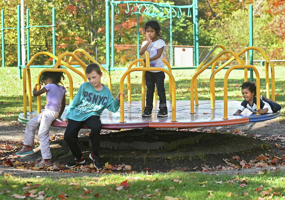Kids play on a merry-go-round on a playground in Frear Park on Tuesday, Oct. 10, 2017 in Troy, N.Y. (Lori Van Buren / Times Union)