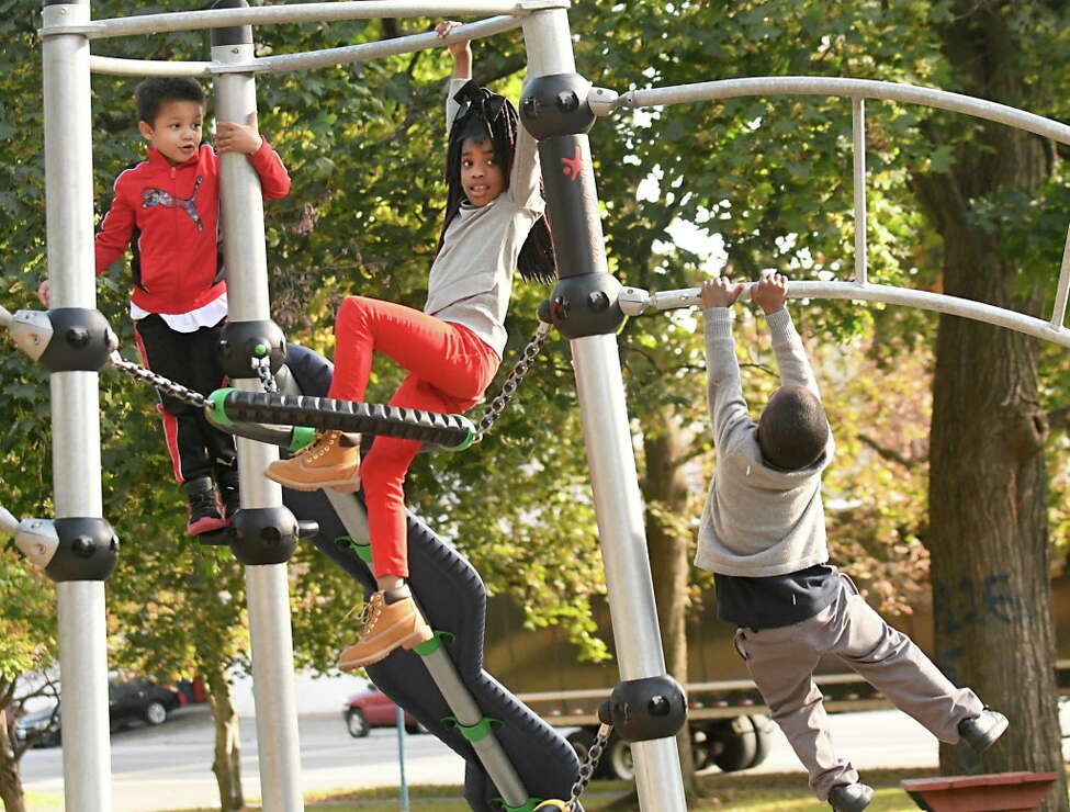 From left, Josiah Marquez, 6, Joy Quinton, 6, and Andrew Edwards, 5, all of Albany play at the Swinburne Park playground on Friday, Oct 13, 2017 in Albany, N.Y. (Lori Van Buren / Times Union)
