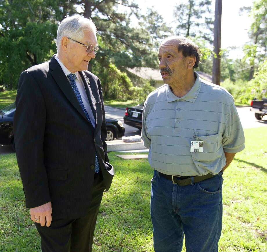 Conroe Mayor Toby Powell, left, talks with Samuel Martinez, a custodian with Conroe ISD, in front of his home, which will be transformed as part of the Community Development Block Grant, Wednesday, April 4, 2018, in Conroe. The federally funded program provides homes for low-income citizens. Photo: Jason Fochtman, Staff Photographer / © 2018 Houston Chronicle