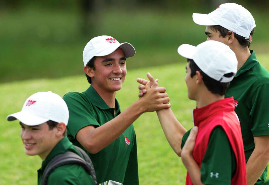 JP Lavalle of The Woodlands celebrates with teammates after finishing -4 under par win the individual title during the final round of the District 12-6A golf tournament at High Meadow Ranch, Wednesday, April 4, 2018, in Magnolia. Photo: Jason Fochtman, Staff Photographer / © 2018 Houston Chronicle