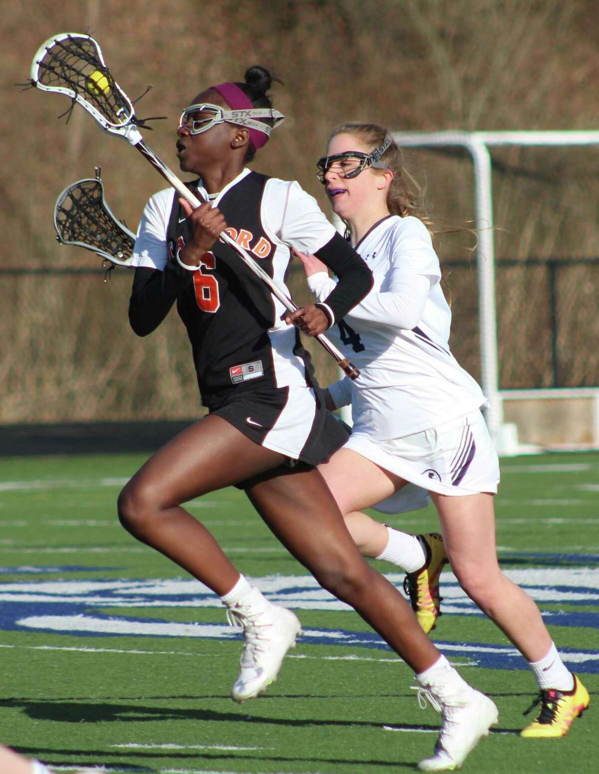 Stamford's Tamia James, left, races upfield with the ball as Immaculate's Molly Gleissner defends during the girls lacrosse game at Immaculate High School in Danbury April 4, 2018.