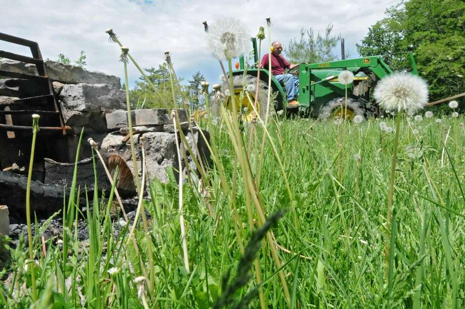 Department of Parks and Recreation employee John Brockley mows the grass in the Paint Mine picnic area at John Boyd Thacher Park in New Scotland.  (Lori Van Buren / Times Union) Photo: LORI VAN BUREN