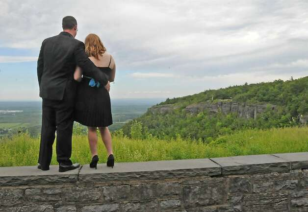 Matthew Brink, 25, and Michelle Curtis, 17, take in the view at Cliff Edge Overlook at John Boyd Thacher Park in New Scotland. The couple said they were planning to attend the Berne-Knox-Westerlo junior prom in the evening.  (Lori Van Buren / Times Union) Photo: LORI VAN BUREN