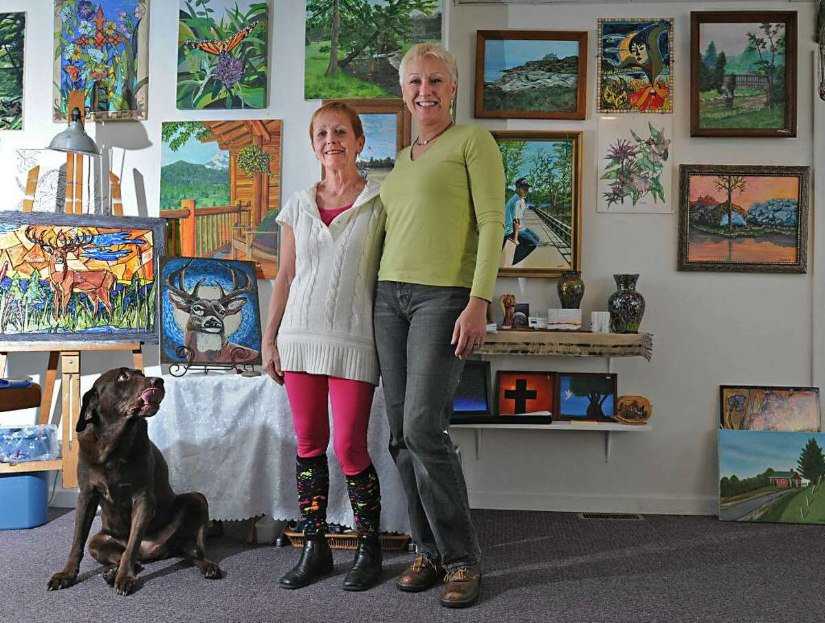 From left, Adirondack Artist Guild members Sher Millis and Shirley Ligiecki stand in their arts shop/gallery on Main Street in Corinth. They reflected on the fire that devastated the village's center two years ago. (Lori Van Buren / Times Union)