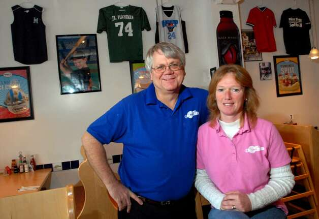 "Business owners Tom and Gail Alverson pose in their sports-themed restaurant, ""The Getaway,"" in Clifton Park in November, 2009. The restaurant caters to families and features local sports, rather than professional athletes and teams. (Cindy Schultz / Times Union) Photo: CINDY SCHULTZ / 00006484A"