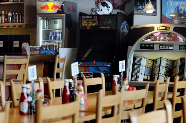 "Here's a view of the games, jukebox and sports paraphernalia at ""The Getaway"" in Clifton Park, owned by Tom and Gail Alverson, which caters to families. (Cindy Schultz  /  Times Union) Photo: CINDY SCHULTZ"