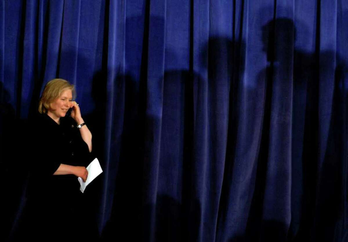 Newly appointed U.S. Senator, Kirsten Gillibrand, takes a congratulator call from President Obama during her appointment ceremony by Gov. David Patterson at the Empire State Plaza, Jan, 23. (Michael P. Farrell / Times Union)