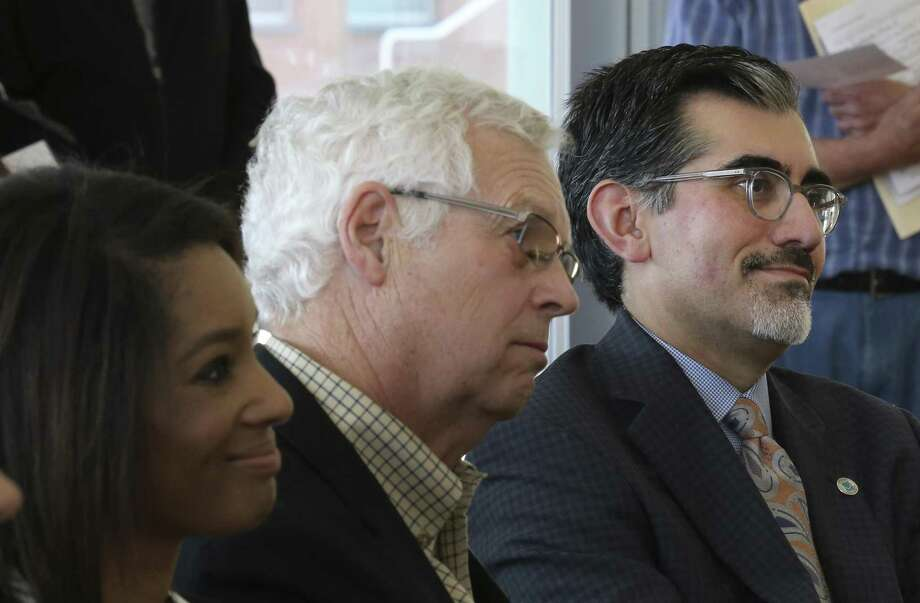 Incoming chancellor of the Alamo Colleges, Mike Flores (right), president of Palo Alto College, is presented at a meet-and-greet at Northeast Lakeview College last week. With Flores taking over soon for Bruce Leslie (left), stability on the Alamo Colleges District board of trustees is best. Photo: Kin Man Hui /San Antonio Express-News / ©2018 San Antonio Express-News