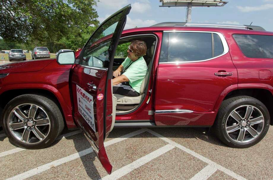 Conroe softball coach Jackie Dixon takes a test drive as part of Wiesner Buick GMC's Buick Drive for Your Student, Thursday, May 18, 2017, in Conroe. The dealership donated $10 for each test drive to Conroe High School, Photo: Jason Fochtman, Staff Photographer / © 2017 Houston Chronicle
