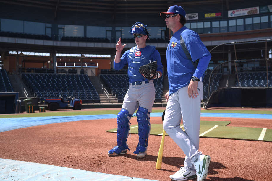 RockHounds manager Scott Steinmann (right) talks with catcher Sean Murphy (left) during practice April 4, 2018, at Security Bank Ballpark. James Durbin/Reporter-Telegram Photo: James Durbin