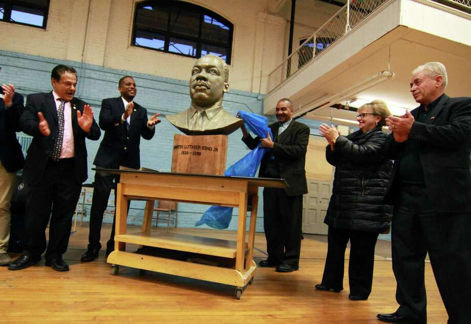 On the 50th anniversary of the assassination of Martin Luther King, Jr., a bust of him was unveiled during a ceremony at the Ansonia Armory in Ansonia, Conn., on Wednesday Apr. 4, 2018. The bust was created by Ansonia resident Vasil Rakaj, standing at right. From left to right is Ansonia Mayor David Cassetti, State Sen. George Logan, Rev. Alfred Smith, State Rep. Linda Gentile and Mr. Rakaj. Photo: Christian Abraham / Hearst Connecticut Media / Connecticut Post