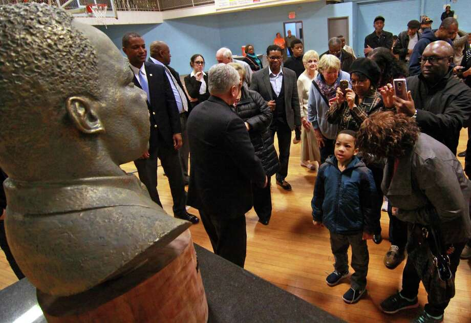 Xavier Best, 5, of Waterbury, gazes up at a bust of the Rev. Dr. Martin Luther King Jr. after it was unveiled during a ceremony at the Ansonia Armory Wednesday, on the 50th anniversary of King's assassination. The bust was created by Ansonia resident Vasil Rakaj. See story, B1 Photo: Christian Abraham / Hearst Connecticut Media / Connecticut Post