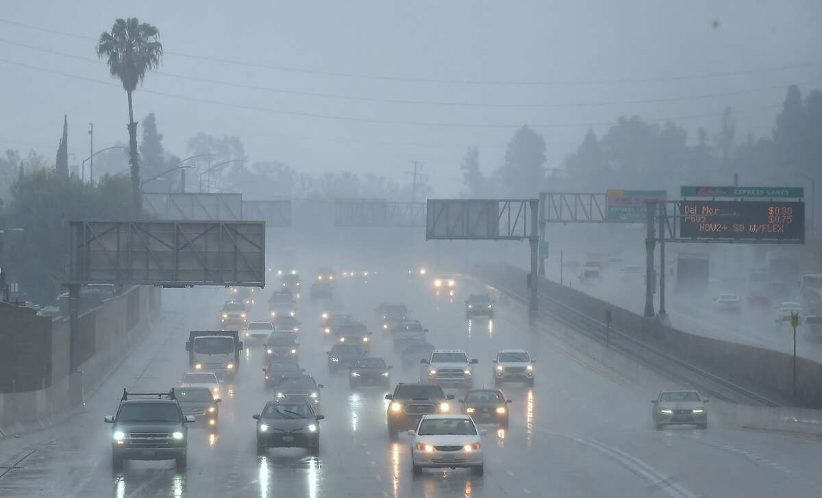 Commuters drive under heavy rainfall in Los Angeles, California on March 21, 2018 A slow-moving storm, billed as an