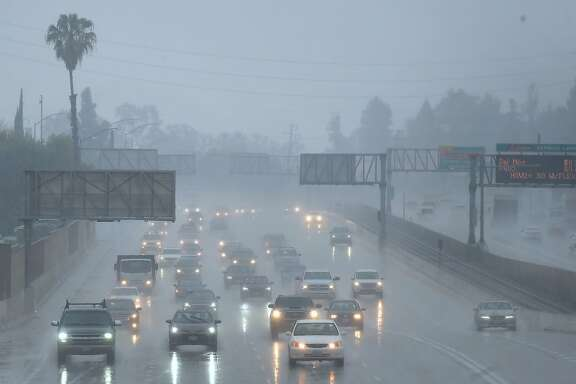 "Commuters drive under heavy rainfall in Los Angeles, California on March 21, 2018 A slow-moving storm, billed as an ""atmospheric river"" began unleashing rain across southern California. Mandatory evacuations have been ordered by officials in Santa Barbara, Ventura and Los Angeles counties. / AFP PHOTO / Frederic J. BrownFREDERIC J. BROWN/AFP/Getty Images"