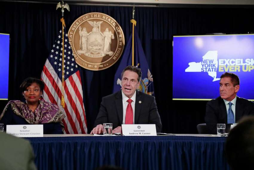 New York Governor Andrew Cuomo, center, speaks during a news conference with Senate Democratic Conference Leader Andrea Stewart-Cousins, D-Yonkers, left, and Independent Democratic Conference Leader Sen. Jeff Klein, D-Bronx, right, Wednesday, April 4, 2018, in New York. (AP Photo/Frank Franklin II)