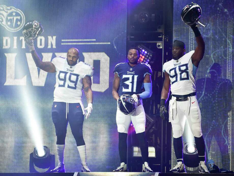 Tennessee Titans defensive tackle Jurrell Casey (99), safety Kevin Byard (31) and linebacker Brian Orakpo (98) show off new uniforms as the NFL football team revealed the redesigned uniforms, in Nashville, Tenn., Wednesday, April 4, 2018. (Andrew Nelles/The Tennessean via AP) Photo: Andrew Nelles, AP / THE TENNESSEAN