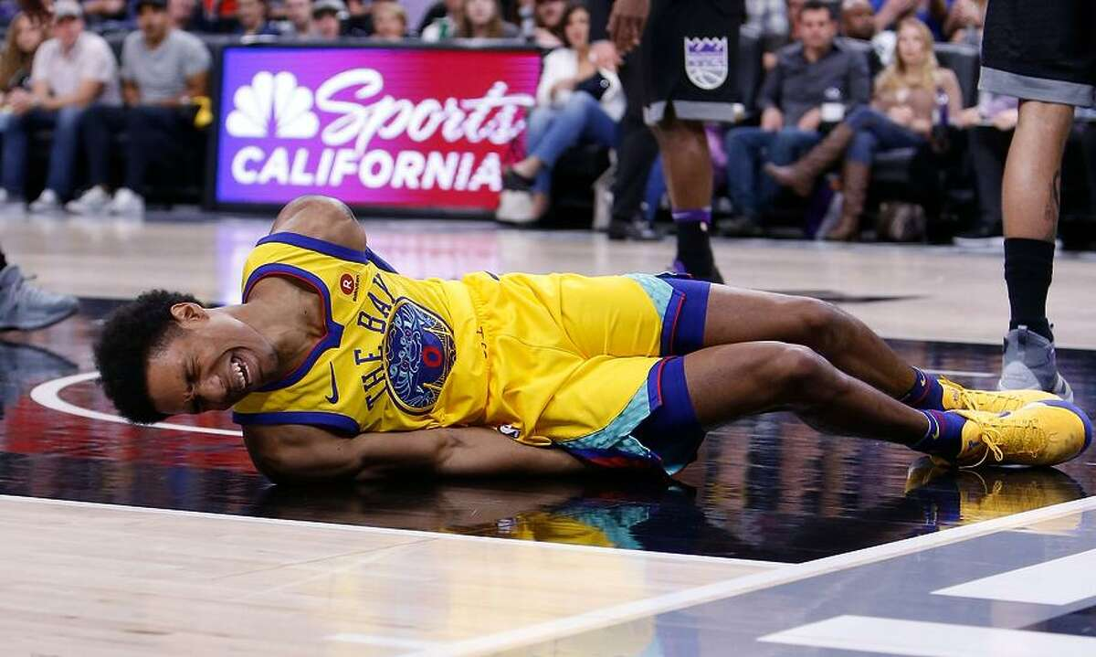 The Warriors' McCaw writhed in pain after landing hard in the third quarter when he was fouled by the Kings' Vince Carter.
