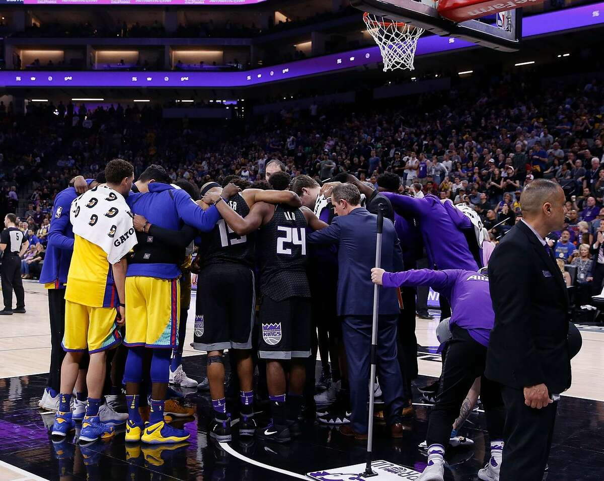Warriors and Kings players come together to pray for Patrick McCaw after he was taken off the court on a stretcher following a fall during the third quarter at Golden 1 Center in Sacramento.