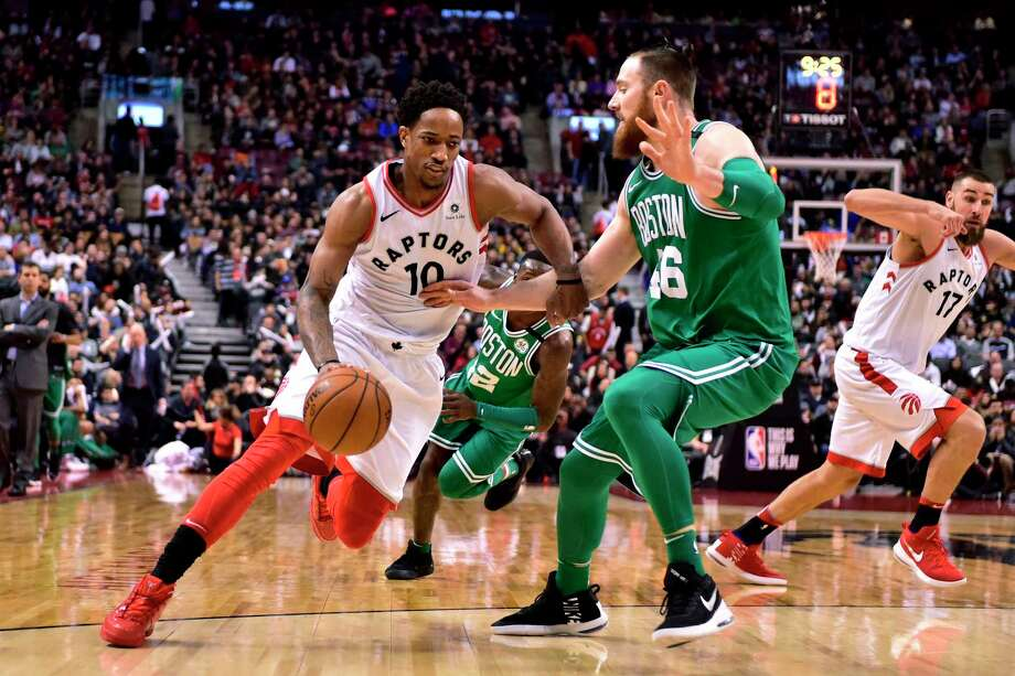 Toronto Raptors guard DeMar DeRozan (10) drives on Boston Celtics centre Aron Baynes (46) during the second half of an NBA basketball game Wednesday, April 4, 2018, in Toronto. (Frank Gunn/The Canadian Press via AP) Photo: Frank Gunn / The Canadian Press