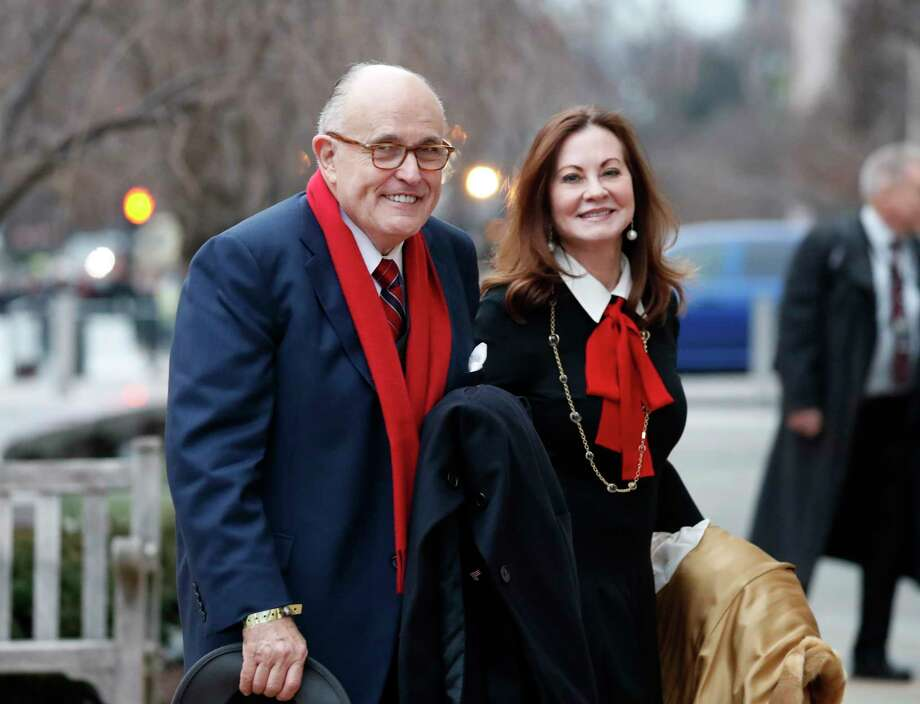 """FILE - In a Friday, Jan. 20, 2017 file photo, Rudy Giuliani and his wife Judith Giuliani, arrives for a church service at St. John's Episcopal Church across from the White House in Washington, on Donald Trump's inauguration day. Judith Giuliani filed divorce papers Wednesday, April 4, 2018, at a court in Manhattan, listing the case as """"contested."""" The filing comes 15 years after the couple was married in Manhattan.  (AP Photo/Alex Brandon, File) Photo: Alex Brandon / Copyright 2018 The Associated Press. All rights reserved."""