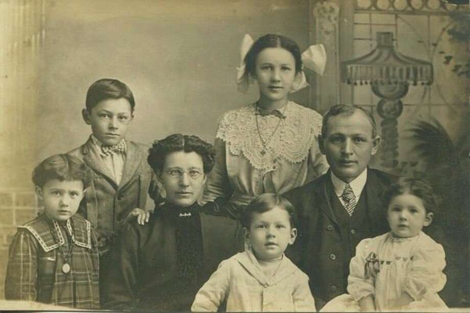 This is Paul and Mae Kuhn with the first five of their seven children. In the corner on the far left is Claressa, next to her is Kenneth. Gettis is the small boy standing between his mom and dad and Katherine is sitting on her father's lap. Their 160 acre 'claim' in North Dakota eventually became a ranch of a thousand acres.