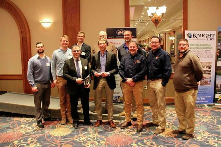 Representatives from Fisher Companies receive an award from the Great Lakes Safety Training Center. (Photo provided)