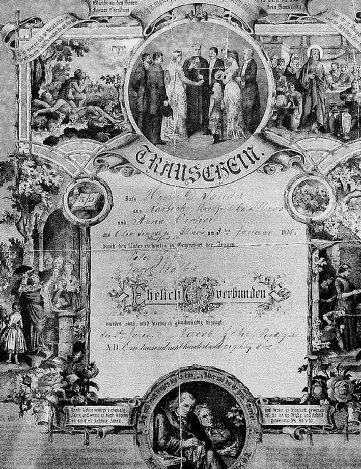An 1886 marriage certificate was discovered in an old German Bible at Books to Benefit in Bloomington. Photo: David Proeber | The Pantagraph (AP)