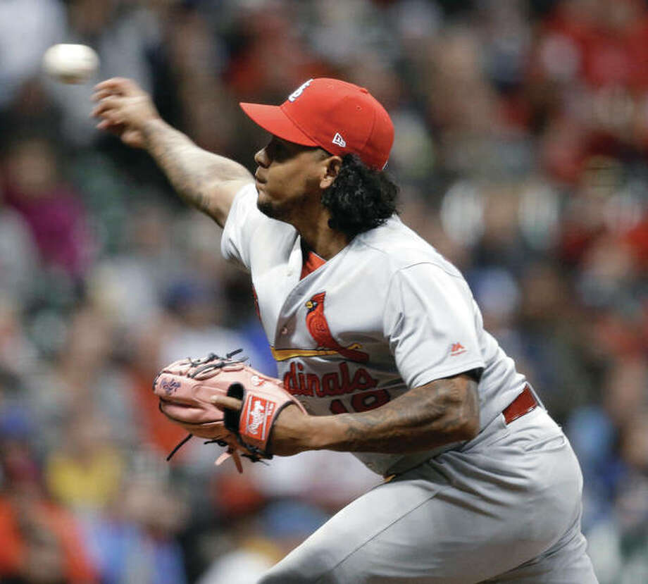 Cardinals pitcher Carlos Martinez throws during the eighth inning of his win Wednesday night in Milwaukee. Photo: AP