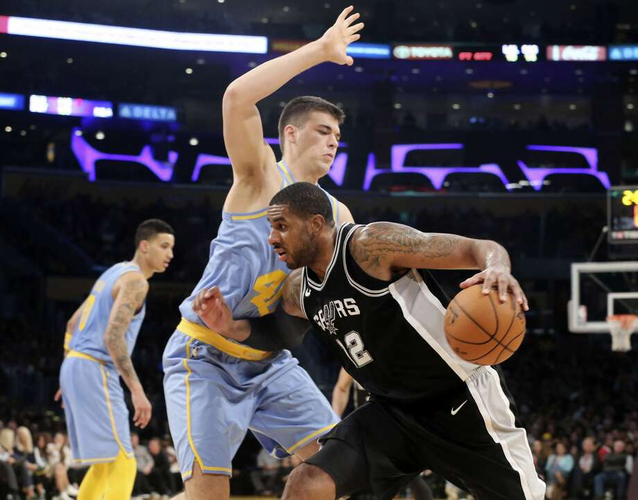 San Antonio Spurs forward LaMarcus Aldridge (12) drives as Los Angeles Lakers center Ivica Zubac (40) defends during the second half of an NBA basketball game in Los Angeles, Wednesday, April 4, 2018. The Lakers won in overtime 122-112. (AP Photo/Reed Saxon) Photo: Reed Saxon/AP