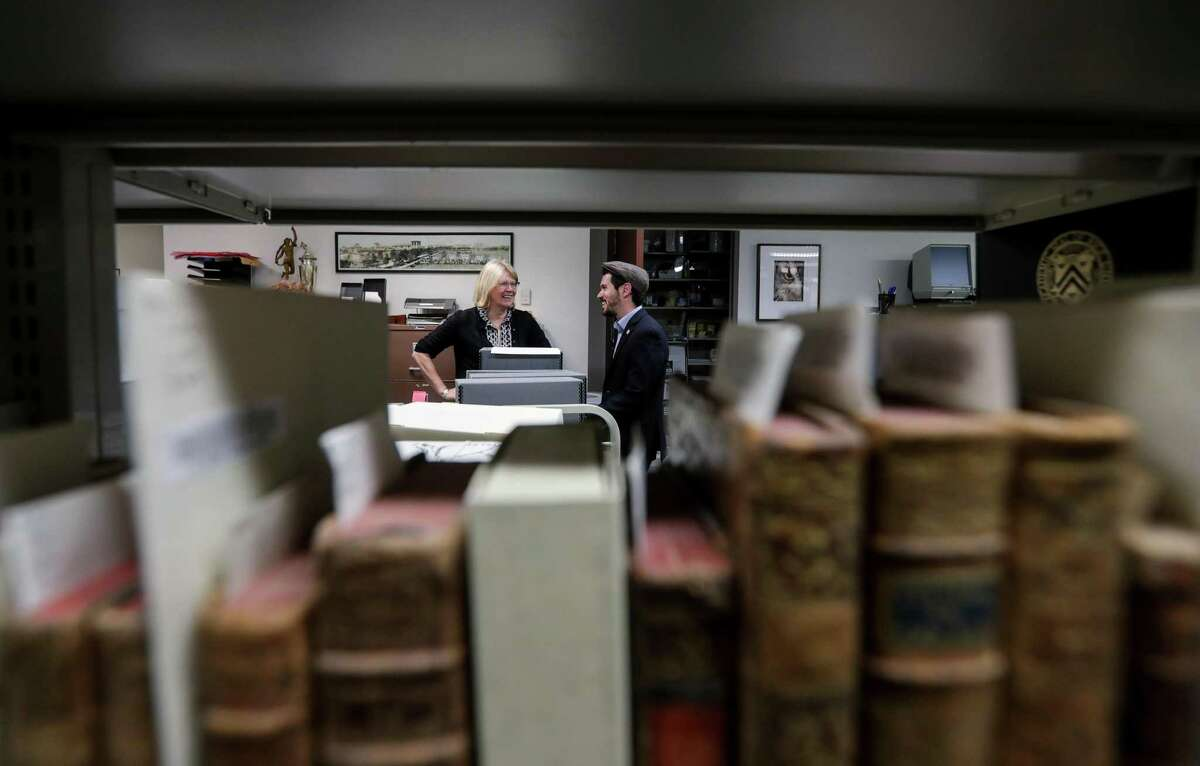 Dr. Melissa Kean, Ph.D., a historian at Rice University, left, and Joshua Furman, a postdoctoral fellow in Jewish studies, talk in the archives of the Woodson Research Center at the Fondren Library, Tuesday, March 27, 2018, in Houston. ( Jon Shapley / Houston Chronicle )