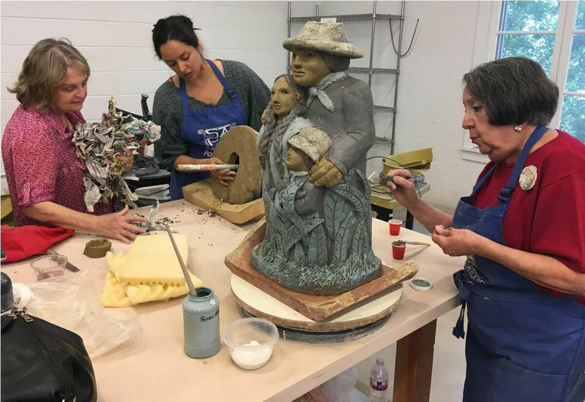Margarita Cabrera, seen here in the center, is working with community members at the Southwest School of Art. Cabrera is the artist behind the