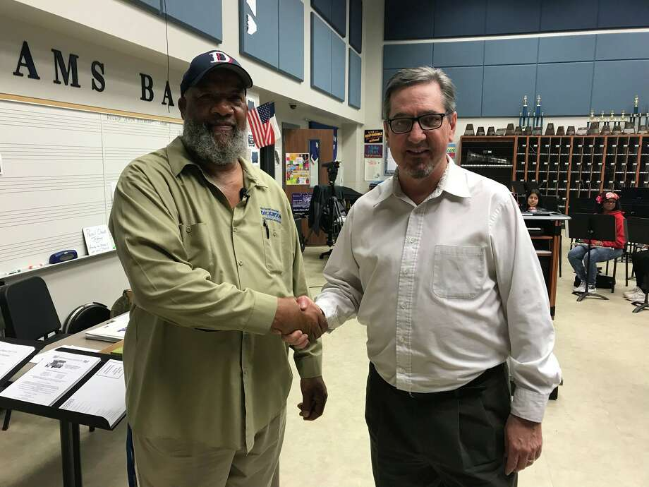 McAdams Junior High School band director John Hinojosa, right, went viral after sharing a video of the school's custodian, Floyd Spry, conducting the band.>> See schools districts that were ranked among the best in Houston. Photo: Leigh Ann Kirkland