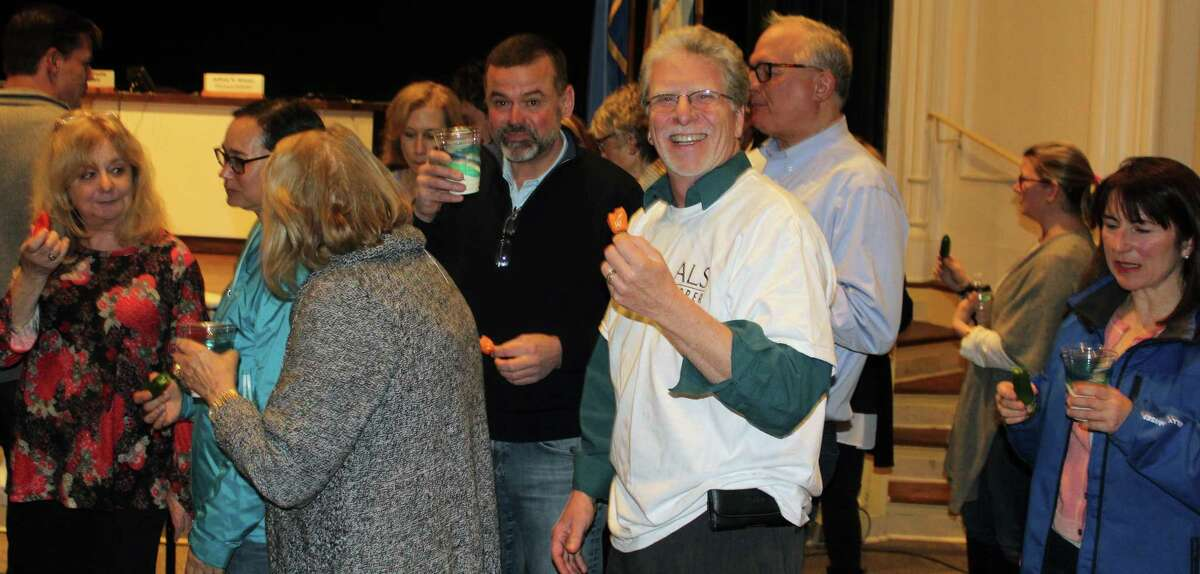 RTM members participate in the ALS hot pepper challenge at the April 3 RTM meeting in Town Hall.