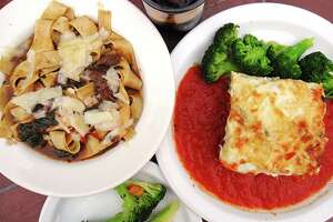 Braised beef cheeks with pappardelle noodles and vegetarian lasagna with marinara, both served with broccoli, from Outlaw Kitchens.