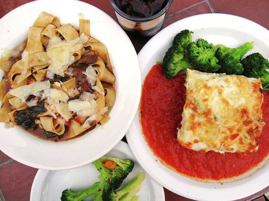 Braised beef cheeks with pappardelle noodles and vegetarian lasagna with marinara, both served with broccoli, from Outlaw Kitchens. Photo: Mike Sutter /San Antonio Express-News