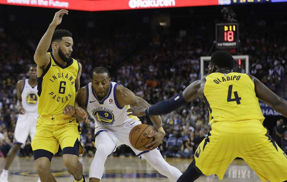 Golden State Warriors' Andre Iguodala (9) works between Indiana Pacers' Cory Joseph (6) and Victor Oladipo (4) during the second half of an NBA basketball game Tuesday, March 27, 2018, in Oakland, Calif. (AP Photo/Marcio Jose Sanchez) Photo: Marcio Jose Sanchez / Associated Press