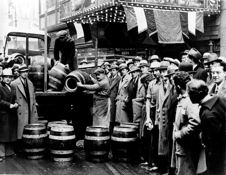 A crowd gathers as kegs of beer are unloaded in front of a restaurant on Broadway in New York City, the morning of April 7, 1933, when low-alcohol beer is legalized again. Photo: Associated Press