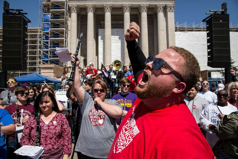 Oklahoma teachers rally in front of the state Capitol to demand pay raises and more school funding Wednesday. Photo: Scott Heins / Getty Images
