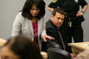 Mark Benavides (right) and defense attorney Liza Rodriguez are in court Thursday during the punishment phase of his trial in Wilson County District Court and Justice Center in Floresville. Benavides, a former San Antonio lawyer, was convicted Tuesday of trafficking in persons and having sex with clients in exchange for legal services.