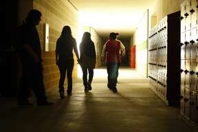 Selected students walk by pristine lockers and freshly painted walls as they see Roybal High School for the first time as they train to be a tour guides at the new school in Los Angeles on August 6, 2008. They will be giving tours to 9th graders and will be explaining the school's methane and hydrogen sulfide mitigation system to visitors. The school, along with many other schools in the L.A. Unified school district, sits atop an oil field that naturally emits small amounts of potentially explolsive and toxic gases. (Photo by Gina Ferazzi/Los Angeles Times via Getty Images)