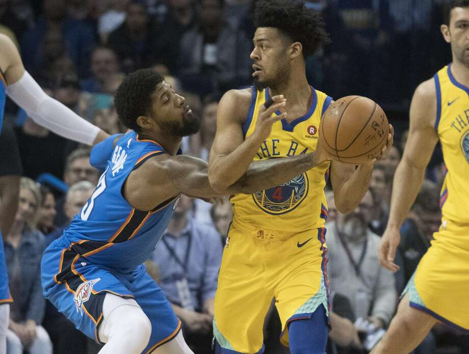 OKLAHOMA CITY, OK - APRIL 3: Paul George #13 of the Oklahoma City Thunder steals the ball from Quinn Cook #4 of the Golden State Warriors during the first half of a NBA  game at the Chesapeake Energy Arena on April 3, 2018 in Oklahoma City, Oklahoma. NOTE TO USER: User expressly acknowledges and agrees that, by downloading and or using this photograph, User is consenting to the terms and conditions of the Getty Images License Agreement. (Photo by J Pat Carter/Getty Images) Photo: J Pat Carter / Getty Images
