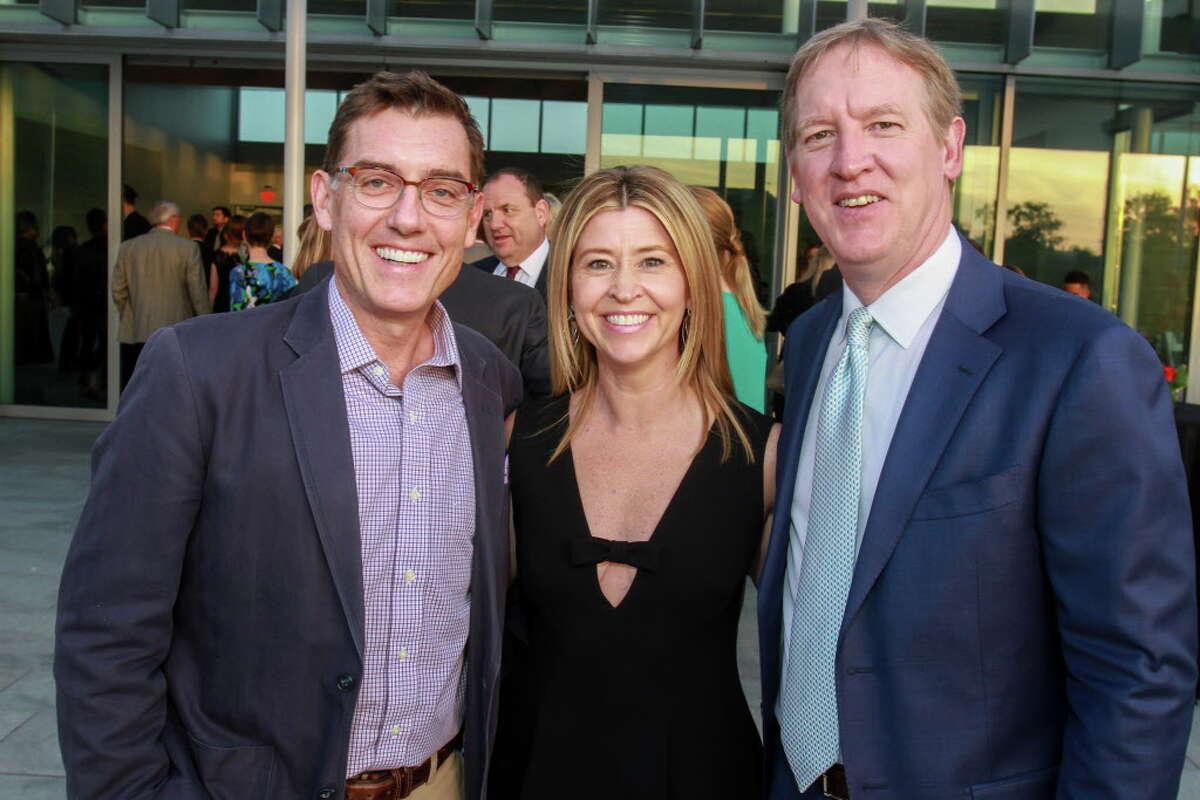 Justin Cronin, left, with chairs Carolyn Roch Henneman and Matt Henneman at the Gulf Coast gala.